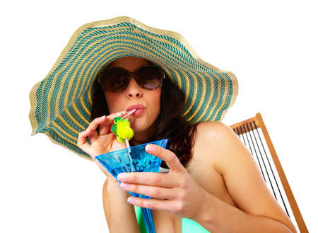 Woman drinking a cocktail  photo