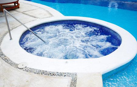 bath tub: hot tub and a swimming pool at caribbean resort