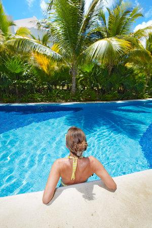 Woman in swimming pool at caribbean resort Stock Photo - 19989495