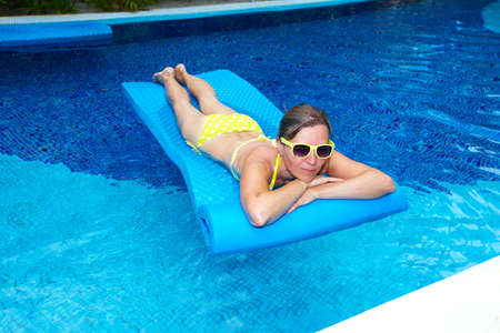 Woman in swimming pool at caribbean resort Stock Photo - 19989492