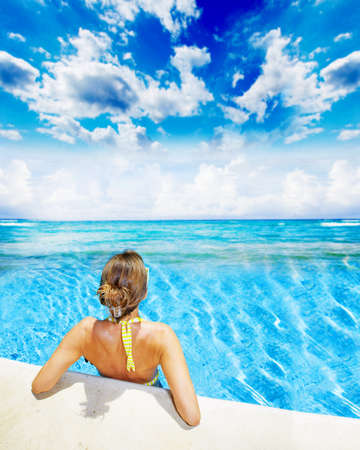 Woman in swimming pool at caribbean resort Stock Photo - 20340614