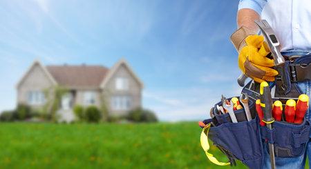 Werknemer met een tool gordel Stockfoto