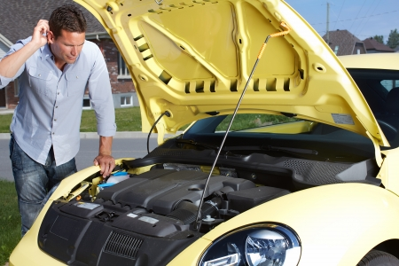Man near broken car. Auto repair service concept. Reklamní fotografie