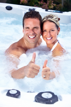 Happy couple relaxing in hot tub. Vacation. Stock Photo - 21492700