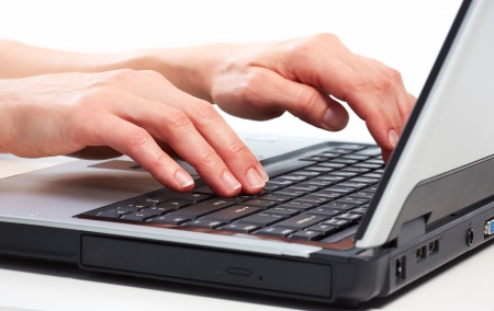 Hands of business woman with laptop computer. Imagens