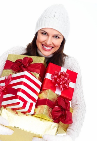 Beautiful christmas girl with gifts isolated on white background.