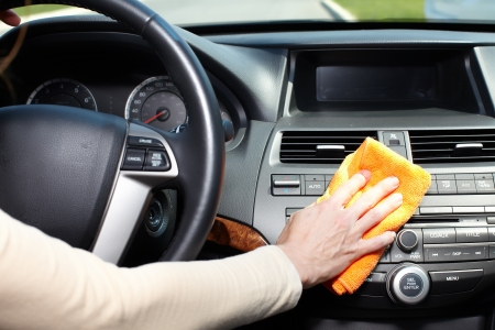 Hand with microfiber cloth cleaning car. Stok Fotoğraf - 21684656