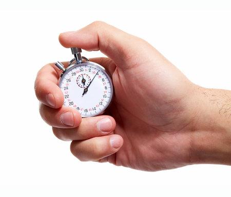 Hand met een stopwatch. Geïsoleerd op een witte achtergrond. Stockfoto