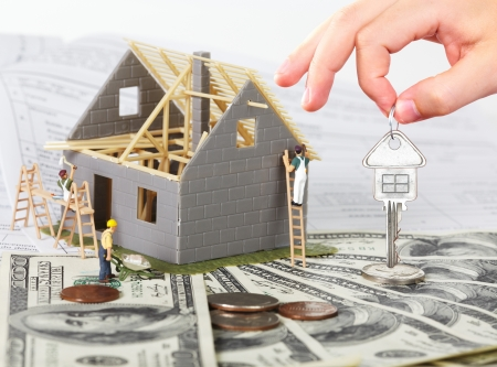 Family house with money and key. Construction background. 免版税图像