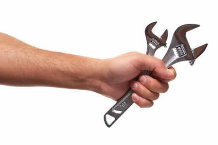 Hand of car mechanic with a wrench. Isolated over white background. 版權商用圖片