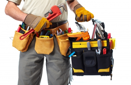 Handyman with a tool belt. Isolated on white background. 版權商用圖片