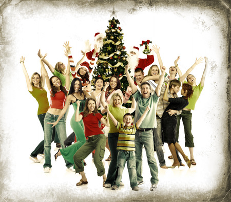 Christmas Tree and happy people. Over grey vintage background. Stock Photo