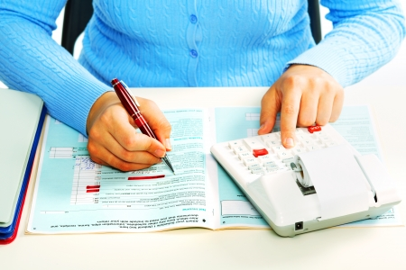 Hands of accountant with calculator and pen. Accounting background. Stockfoto