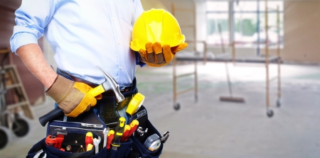 Arbeider met een tool gordel. Geïsoleerd over witte achtergrond. Stockfoto - 22724329