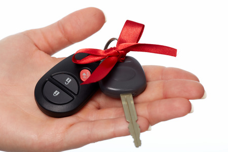 Car keys. Auto dealership and rental concept background. Banco de Imagens