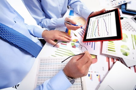 Hands with tablet computer. Finance and accounting business.