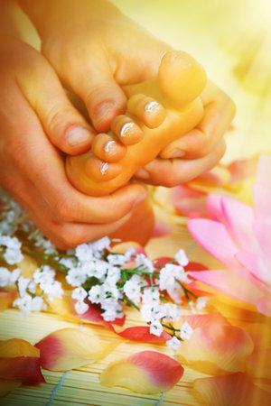 Beautiful woman feet in spa massage salon.