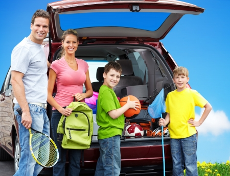 Happy family near new car. Camping concept background. Archivio Fotografico