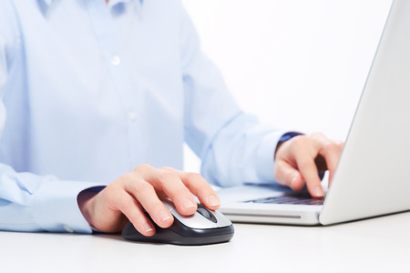 Hands of businessman with laptop. Technology and internet.