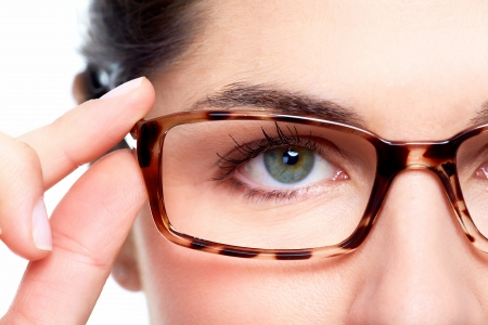 Eyeglasses. Woman wearing eyeglasses. Optometrist background. Archivio Fotografico