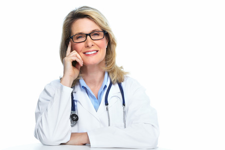 Smiling mature doctor woman  Isolated over white background  Stock Photo