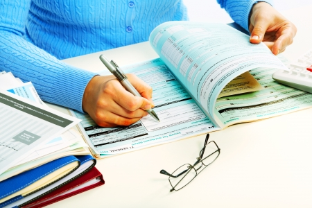Hands of accountant in office. Accounting background. 版權商用圖片