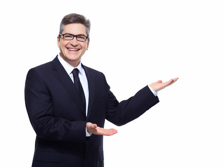 Businessman isolated over white background presenting copyspace.