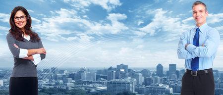Business team over blauwe stedelijke achtergrond Succes