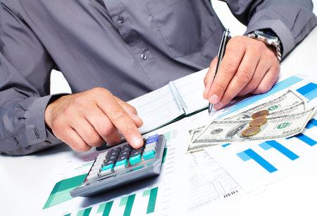 Hand with a calculator  Money saving concept