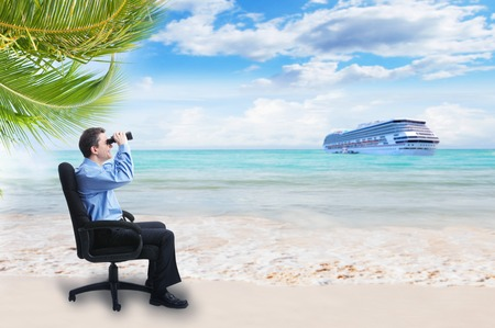 Businessman with binoculars on the beach