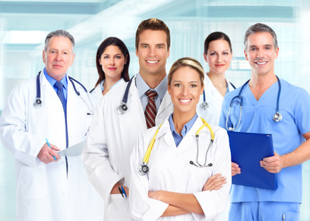 Group of medical doctors over blue hospital  Stock Photo