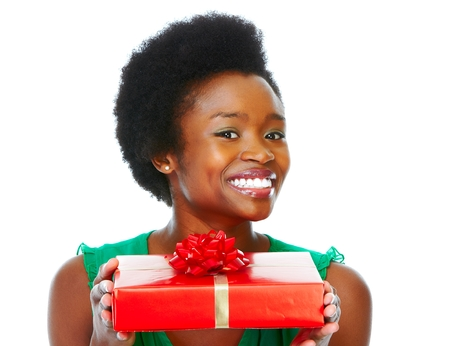 Beautiful african girl with gift. Stock Photo