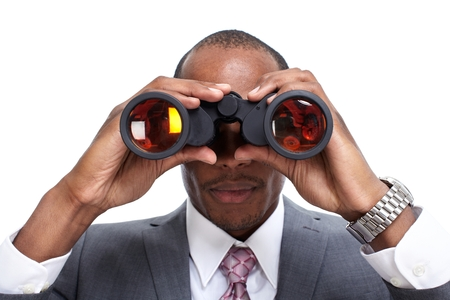 African-American businessman with binoculars. Stock Photo