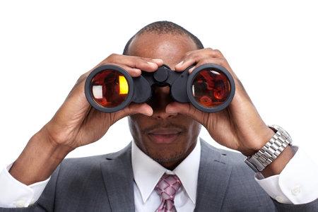 Uomo d'affari afro-americano con il binocolo. Archivio Fotografico - 34634596