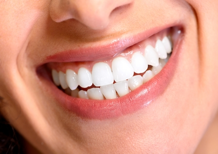 Beautiful young woman smile. Dental health background. Stock Photo