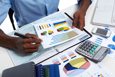 Hands of black businessman with calculator. Accounting