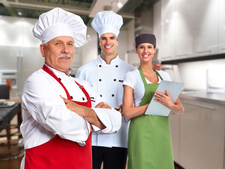 Senior professional chef man and group of people