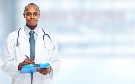 African-American doctor man writing prescription