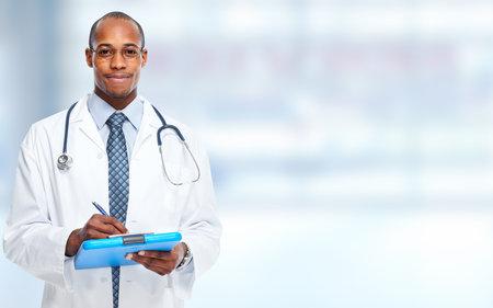 African-American doctor man writing prescription