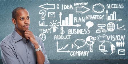 Zwarte zakenman die bedrijfsregeling kijkt. Stockfoto
