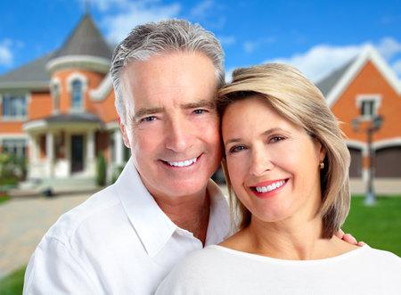 Senior Couple near new house.