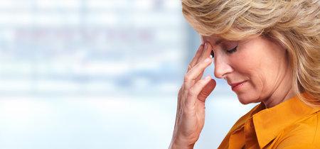 Woman having migraine headache.