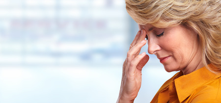 Woman having migraine headache.