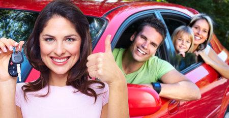 Woman holding car key.