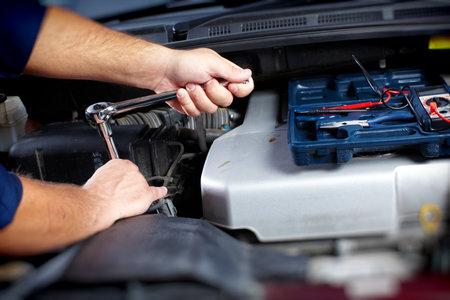 Mechanic working in auto repair garage Stock fotó