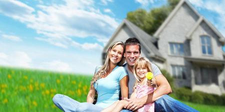 Family near new house. Stock Photo - 36857859