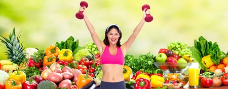 Happy young woman over diet background. Banque d'images