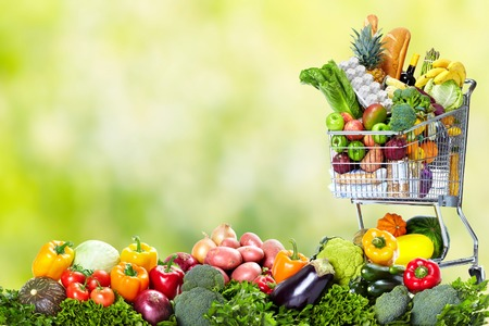 Shopping cart with vegetables and fruits. Stok Fotoğraf