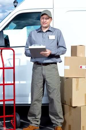 Postman with parcel box. Stock Photo - 37495568