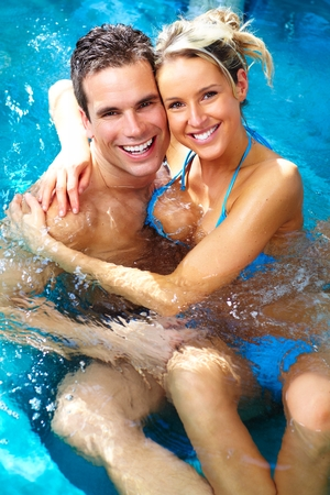 Young couple relaxing in bath tub.